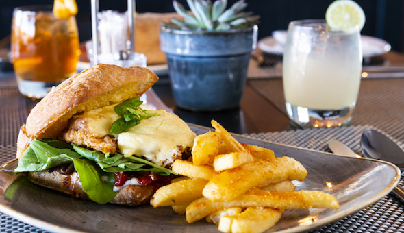Gourmet Burgers with Fries or Wedges for up to 4 People at Canal Café, located at the 4-Star aha Harbour Bridge Hotel!
